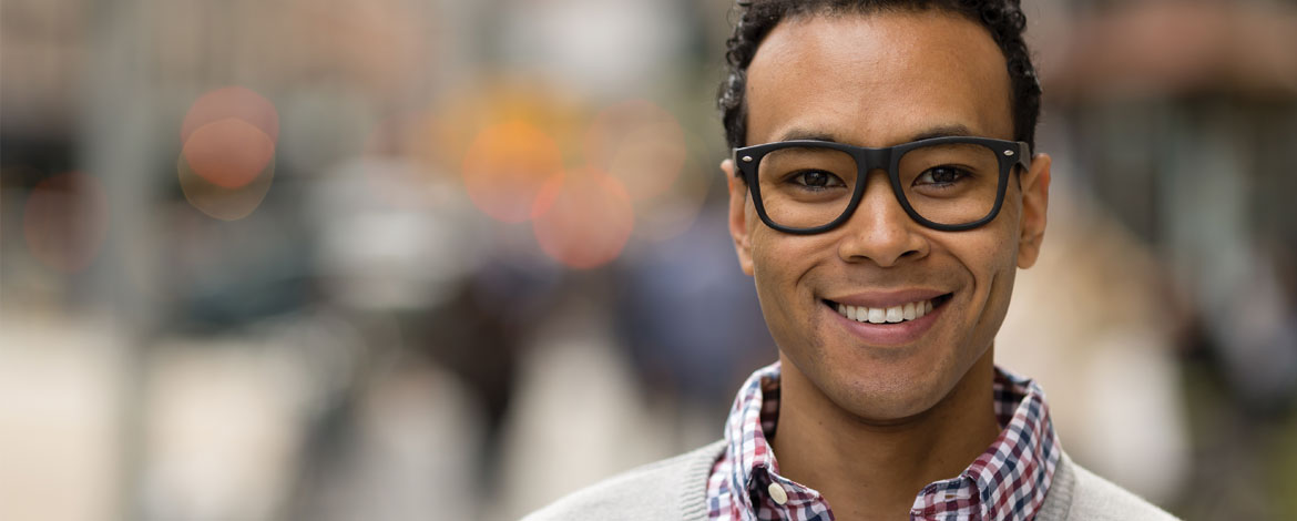 black man smiling eyeglasses